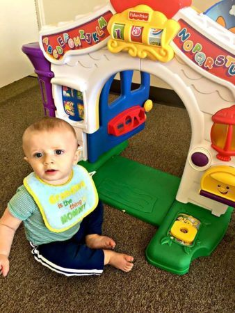 toddler_boy_playing_with_door_toy_cadence_academy_preschool_rosemeade_carrollton_tx-338x450