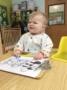 toddler_boy_smiling_while_coloring_carolina_kids_child_development_center_rock_hill_sc-333x450