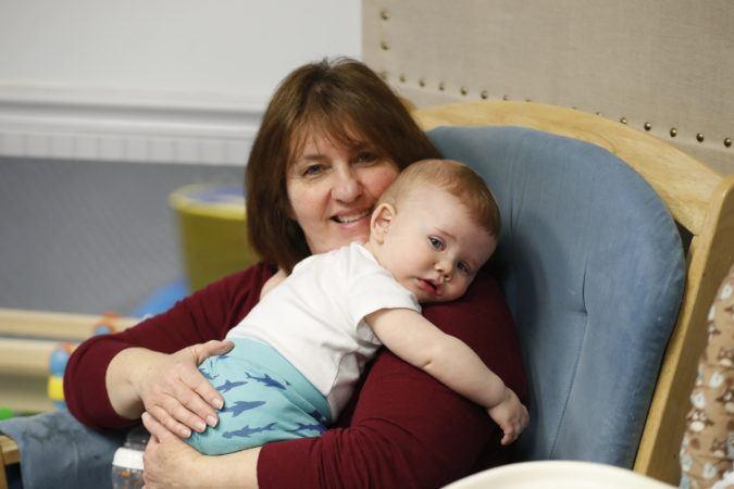 toddler_cuddling_with_teacher_winwood_childrens_center_leesburg_va-675x450