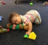 toddler_cuddling_with_teddy_bear_growing_kids_academy_fredericksburg_va-471x450
