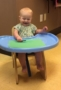 toddler_drawing_in_high_chair_creative_expressions_learning_center_eureka_mo-307x450
