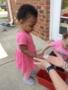toddler_getting_seeds_to_plant_carolina_kids_child_development_center_rock_hill_sc-338x450