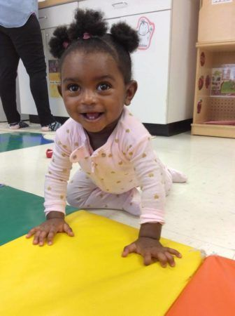 toddler_girl_crawling_on_colorful_mat_winwood_childrens_center_gainesville_ii_va-336x450