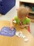 toddler_girl_doing_foil_art_project_at_cadence_academy_preschool_kenton_huntersville_nc-336x450 (1)