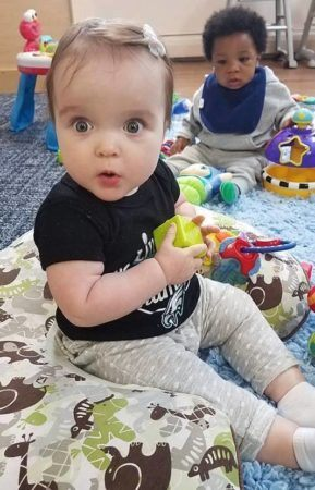 toddler_girl_looking_amazed_at_cadence_academy_plymouth_meeting_pa-289x450