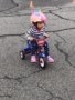 toddler_girl_on_tricycle_growing_kids_academy_fredericksburg_va-338x450