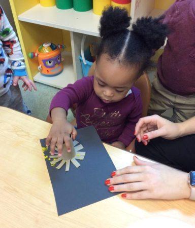 toddler_girl_painting_with_cardboard_tube_brush_growing_kids_academy_fredericksburg_va-384x450