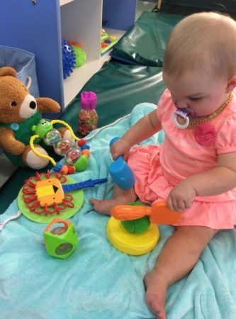 toddler_girl_playing_with_hammer_and_shovel_growing_kids_academy_fredericksburg_va-333x450