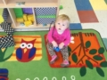 toddler_girl_playing_with_large_block_at_cadence_academy_preschool_lexington_sc-600x450