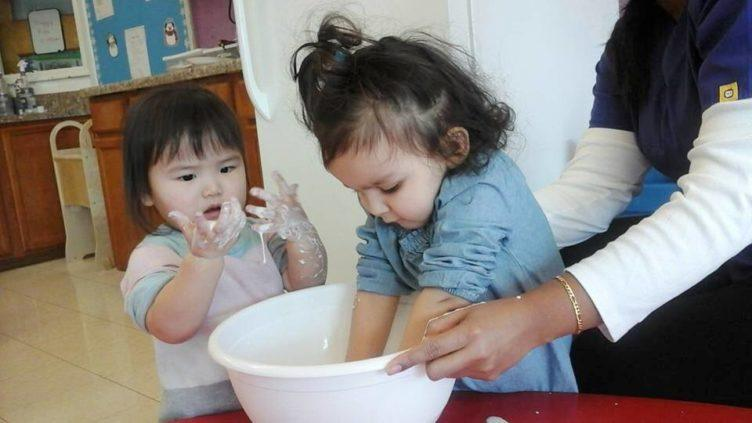 toddler_girls_getting_dirty_during_cooking_activity_prime_time_early_learning_centers_edgewater_nj-752x423