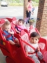 toddler_in_bye-bye_buggy_at_cadence_academy_preschool_lexington_sc-338x450