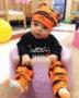 toddler_in_pumpkin_jammies_sitting_in_bumbo_seat_cadence_academy_preschool_mauldin_sc-360x450