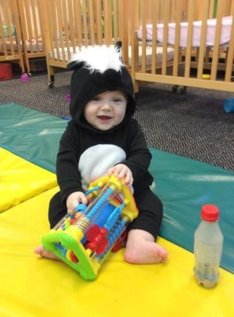 toddler_in_skunk_costume_growing_kids_academy_fredericksburg_va-332x450
