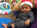 toddler_lounging_in_santa_hat_cadence_academy_preschool_steele_creek_charlotte_nc-1024x765-602x450
