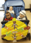 toddler_on_stroller_ride_at_cadence_academy_eastfield_huntersville_nc-320x450
