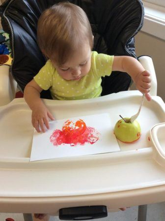 toddler_painting_with_an_apple_at_next_generation_childrens_centers_sudbury_ma-336x450