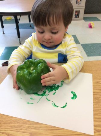 toddler_painting_with_bell_pepper_next_generation_childrens_centers_sudbury_ma-336x450