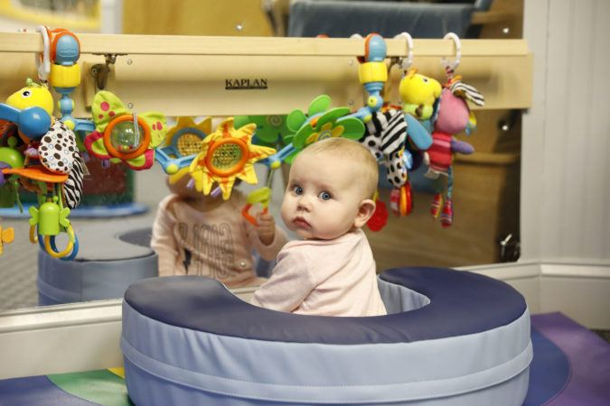 toddler_playing_in_cushioned_seat_winwood_childrens_center_leesburg_va-675x450