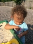 toddler_playing_with_sand_cadence_academy_northlake_charlotte_nc-336x450