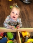toddler_playing_with_small_toys_sunbrook_academy_at_bay_springs_villa_rica_ga-338x450