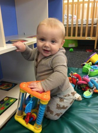 toddler_playing_with_toys_on_mat_growing_kids_academy_fredericksburg_va-333x450