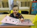 toddler_reading_large_book_winwood_childrens_center_fairfax_va-600x450