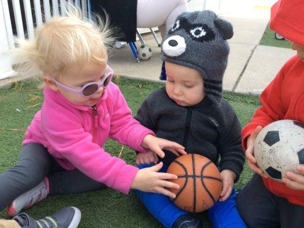 toddler_sharing_basketball_canterbury_academy_at_prairie_ridge_olathe_ks-600x450