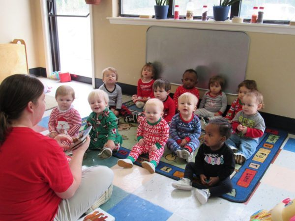 toddler_teacher_reading_book_at_cadence_academy_preschool_harbison_columbia_sc-600x450