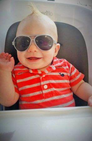 toddler_with_sunglasses_in_high_chair_cadence_academy_preschool_surfside_myrtle_beach_sc-294x450