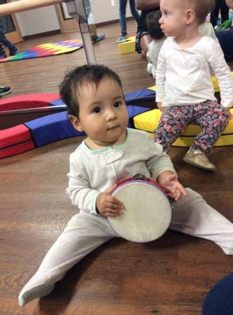 toddler_with_tambourine_cadence_academy_preschool_cypress_houston_tx-333x450