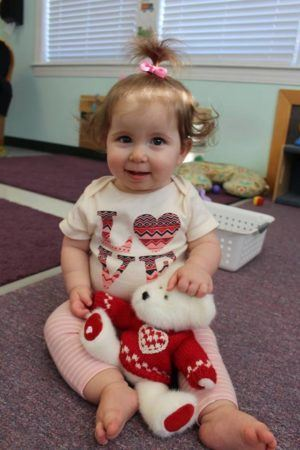 toddler_with_teddy_bear_at_next_generation_childrens_centers_hopkinton_ma-300x450
