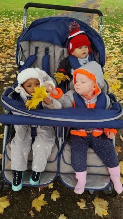toddlers_going_for_ride_in_stroller_cadence_academy_preschool_brentwood_portland_or-253x450
