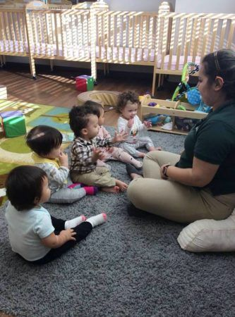 toddlers_in_circle_time_with_teacher_at_cadence_academy_preschool_cypress_houston_tx-333x450