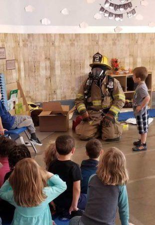 visit_from_firefighter_fredericksburg_childrens_academy_fredericksburg_va-311x450