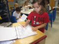 writing_activity_during_kindergarten_club_cadence_academy_preschool_main_street_normal_il-600x450