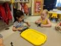preschool_girls_playing_with_fish_winwood_childrens_center_south_riding_va-600x450