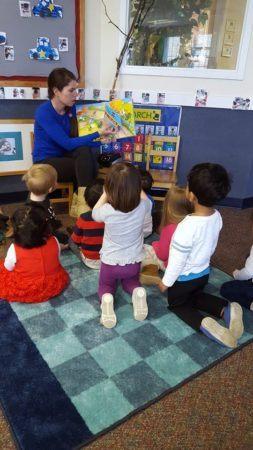 preschool_teacher_reading_to_students_winwood_childrens_center_south_riding_va-253x450