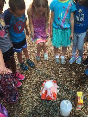 preschoolers_enjoying_volcano_on_playground_winwood_childrens_center_south_riding_va-338x450