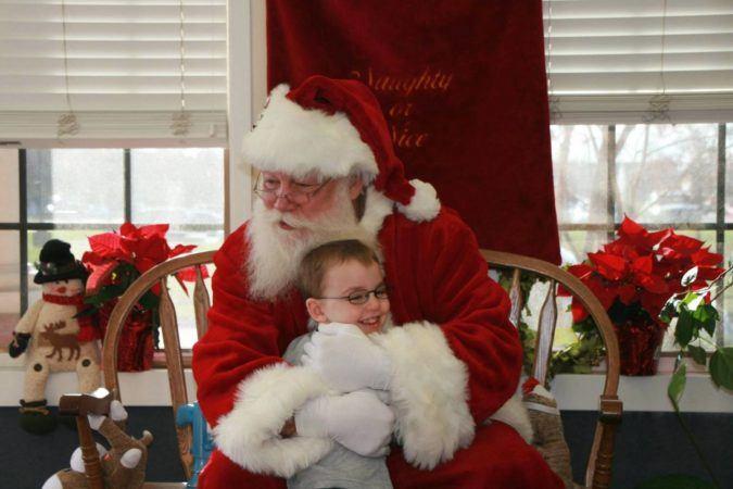 santa_hugging_preschool_boy_winwood_childrens_center_south_riding_va-675x450